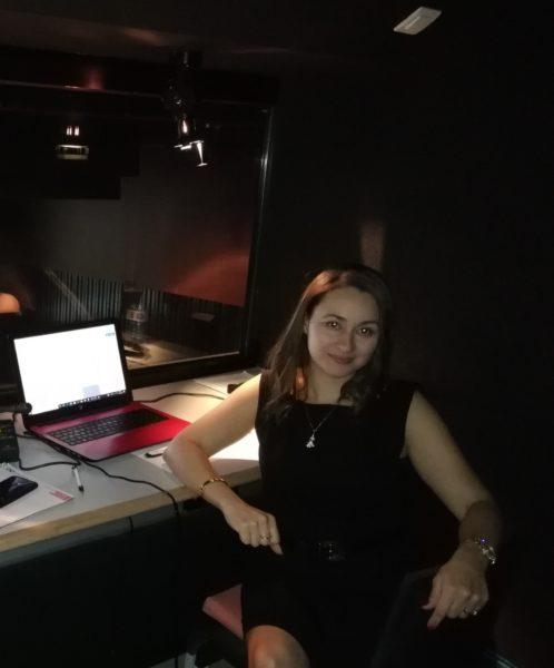 Amel Mokdad in an interpreting booth